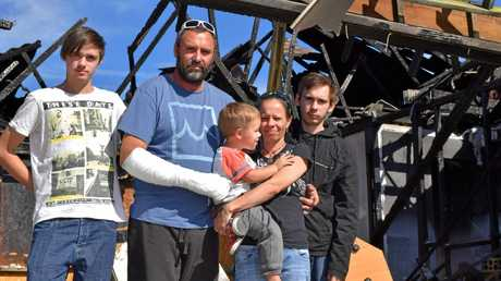 IN NEED: Elijah, Christian, Phoenix and Steven Russell and Nicole Wright are counting the losses after their Deebing Heights house burned on the weekend.