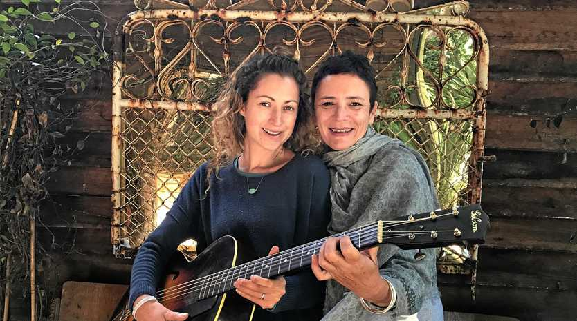 GOLDEN: Co Owner of Valiant Music Elie Zaragoza with Old and Gold co-ordinator Cherie Heale at the Bruns Bakery with a 1949 Gibson acoustic guitar.