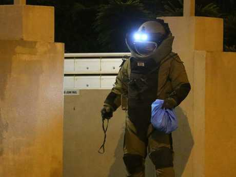 A bomb squad police officer at the scene of the siege.