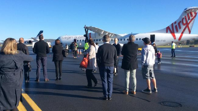A man has been arrested on the tarmac at Albury airport after an incident on a Virgin Australia flight from Sydney.