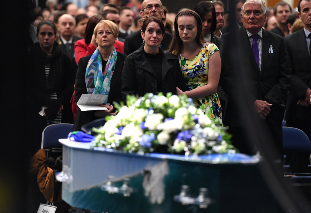 Senior Constable Brett Forte's wife Susan stands next to her daughter Emma during his funeral in Toowoomba, Wednesday, June 7, 2017. Senior Constable Forte was killed on May 29 near Gatton, when gunman Ryan Maddison opened fire on officers before he was eventually shot dead after an overnight siege. (AAP Image/Dan Peled) NO ARCHIVING