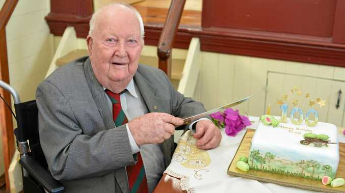 MILESTONE: Fred From cuts his 100th birthday cake at his party held at the Forest Hill Hall.