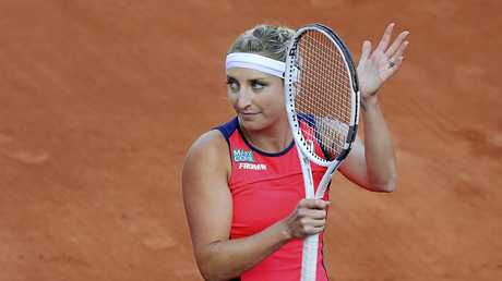 Timea Bacsinszky of Switzerland applauds after defeating France's Kristina Mladenovic during their quarterfinal match
