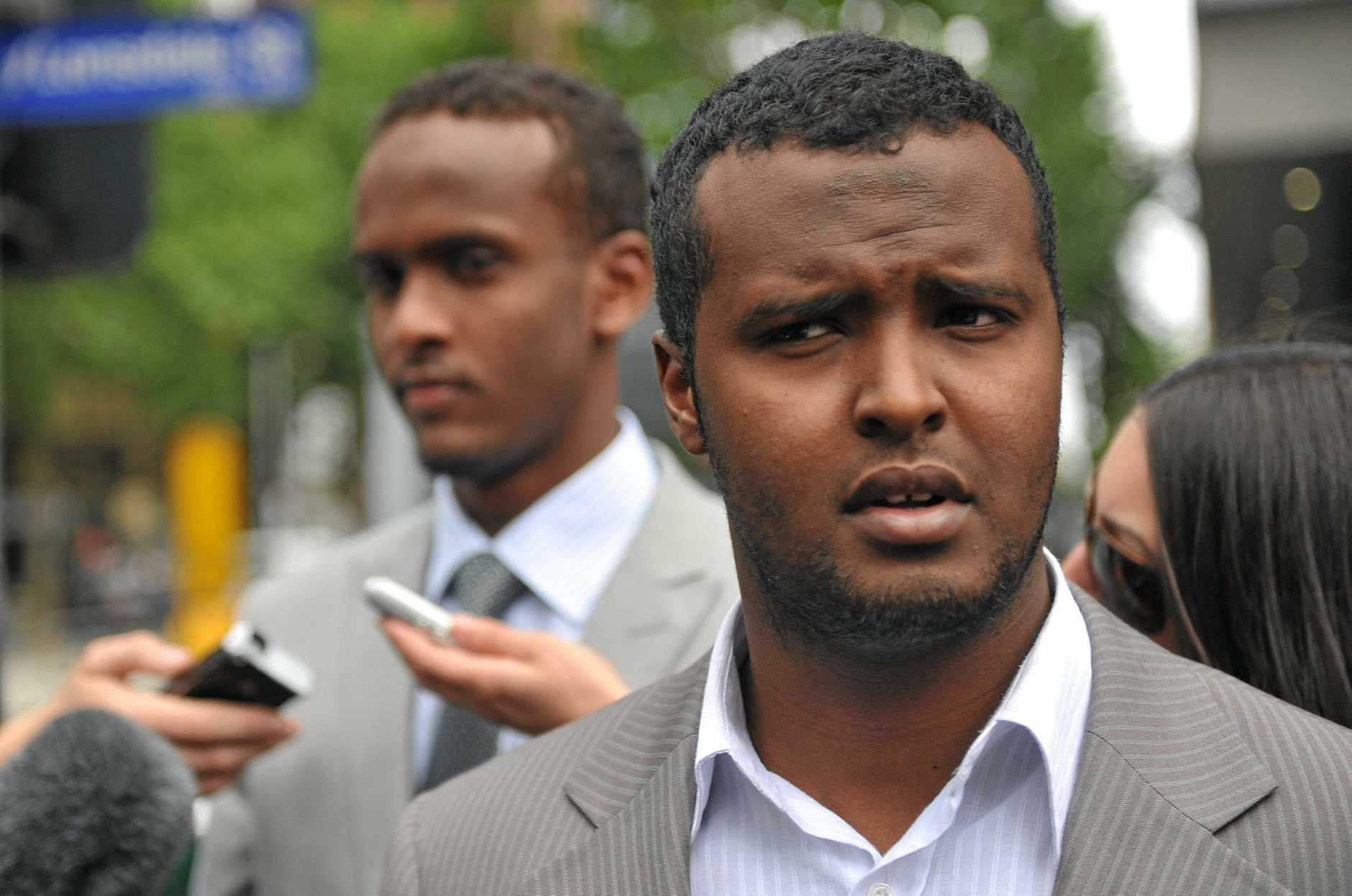 Yacqub Khayre (right) and Abdirahman Amend leave court in Melbourne, Thursday, Dec. 23, 2010. The two men were acquitted by a Supreme Court jury, of planning an alleged terrorist attack on the Holsworthy army base in Sydney, while the other three co-accused were found guilty. (AAP Image/Julian Smith) NO ARCHIVING