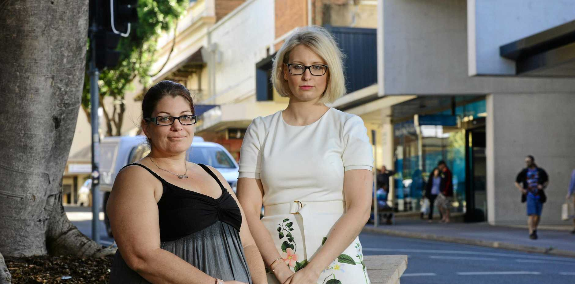 LUCKY ESCAPE: Car crash victim Kirra-Anne Lemon and Maurice Blackburn Ipswich leader Stephanie Francis are reminding people to drive safely.
