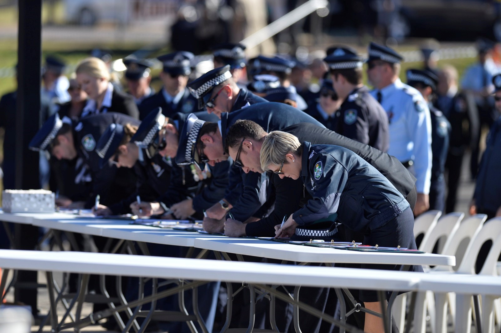 Mourners gather to pay their respects to Senior Constable Brett Forte.