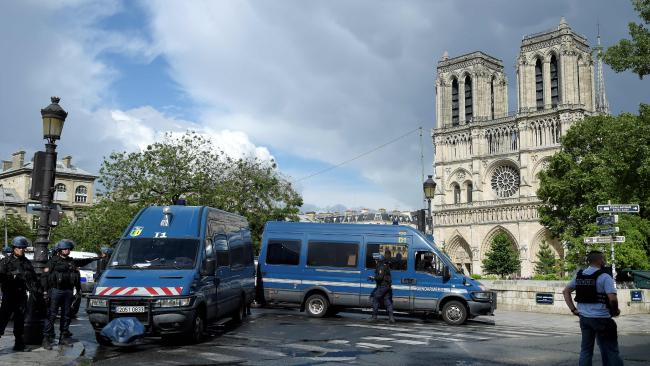 Police outside the iconic Notre Dame cathedral in Paris. Picture: AFP/Bertrand Guay