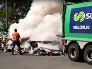 Garbage truck bursts into flames, dumps load on road