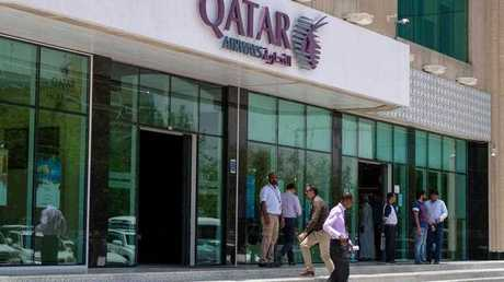 People walk past the Qatar Airways headquarters in Doha, Qatar, 06 June 2017. Saudi Arabia announced on 06 June the cancellation of all operating licenses granted to Qatar Airways and ordered the closure within 48 hours of all its offices in the country