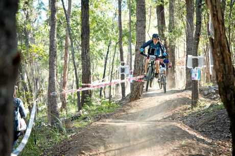 Ethan Hellwege from Mercy College leads Guy Dobbins from MCC during the national MTB race.