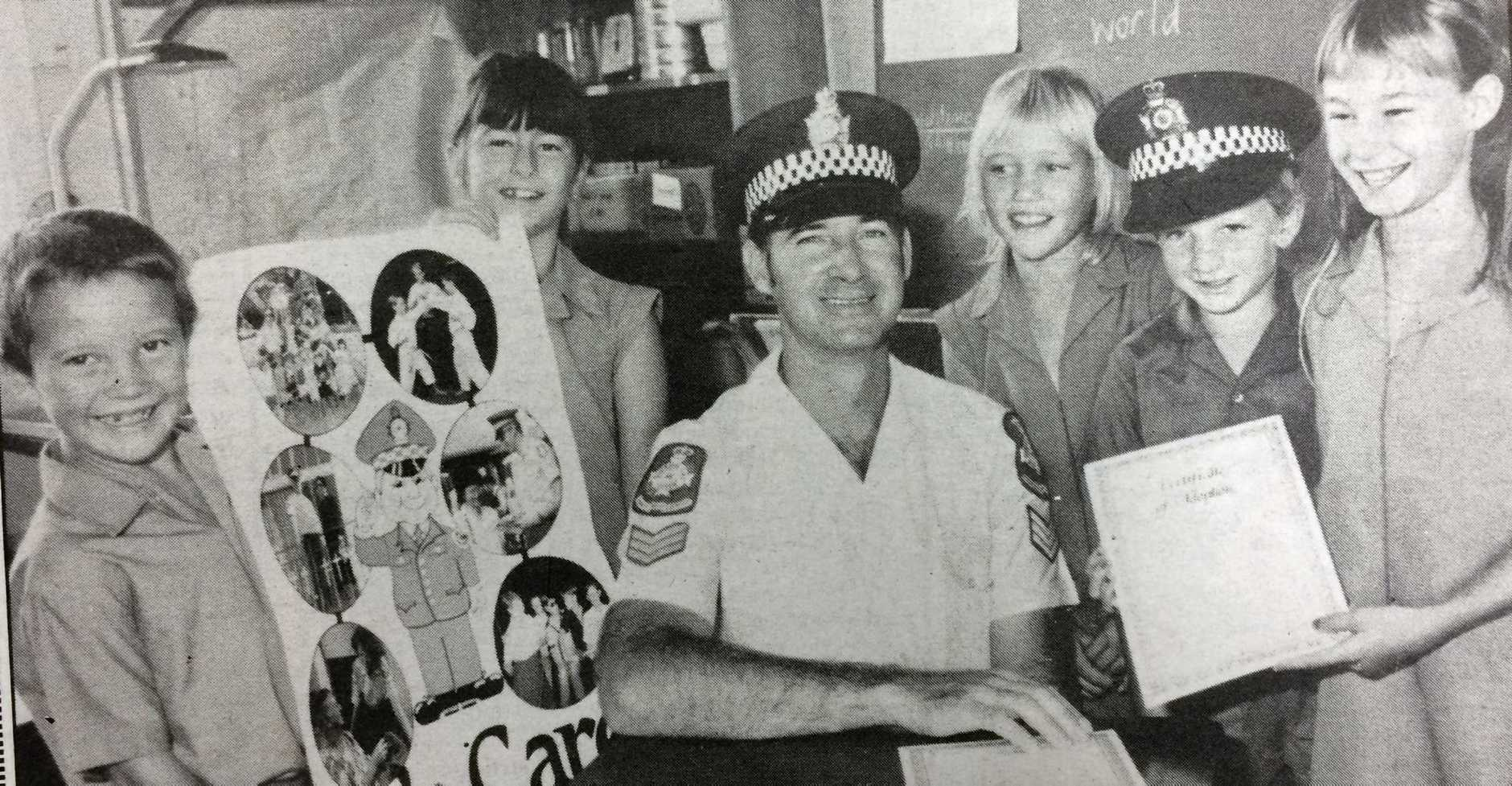 WEDNESDAY, FEBRUARY 22, 1989: Gympie policeman Sgt Steve Seed made friends with Gympie East State School students (from left) Hugh Swingler, Alison Wilson, Deanne Burkhardt, Glenn Mullaly and Karen Seed yesterday when the school adopted Sgt Seed through the adotp-a-cop program.