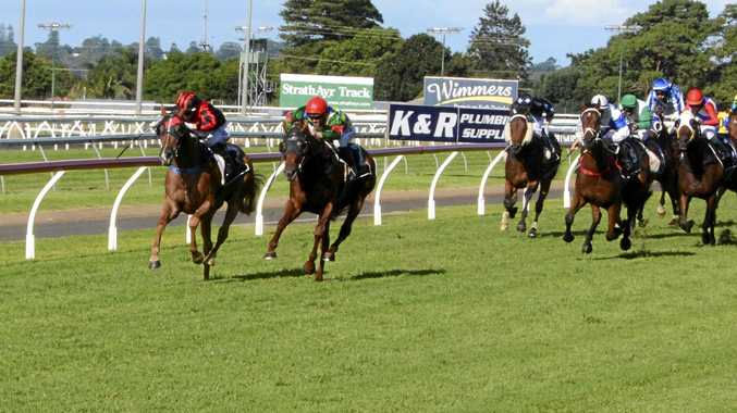 CLOSING STAGES: Dreams Aplenty (inside) and Spring Tycoon keep Dazzle Em Sid at bay in the Toowoomba Guineas at Clifford Park.