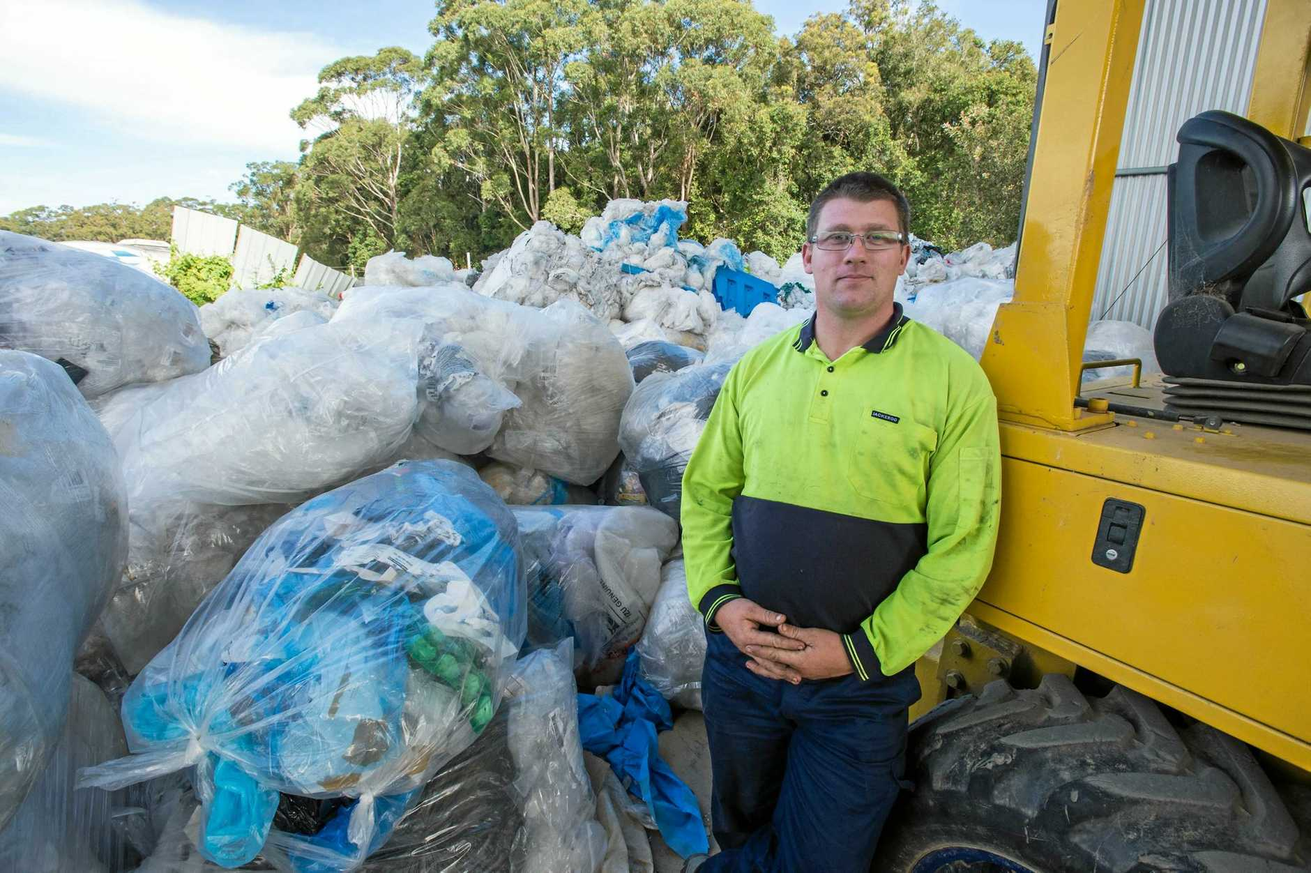 WASTE NOT: Shawn O'Rourke with the soft plastics processed by Coffs Harbour Paper and Oil