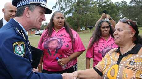 The former NSW Commissioner of Police, Andrew Scipione, apologised to Evelyn's great aunt Clarice Greenup in August last year, with Rebecca Stadhams, Evelyn's mother, and Michelle Jarrett in the background.