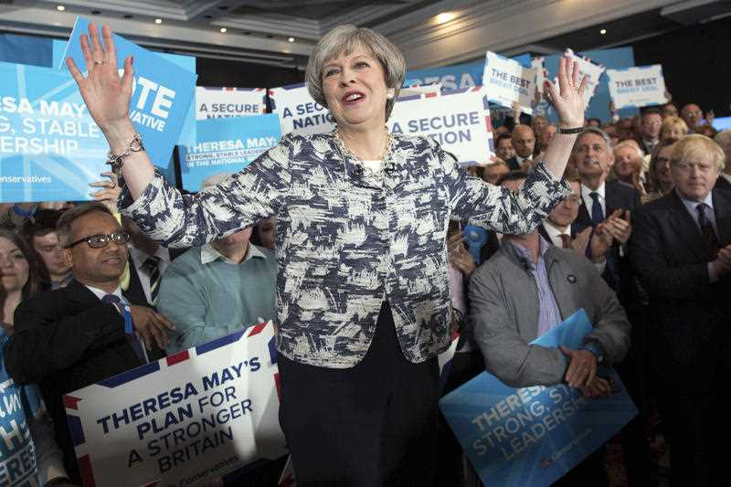 Britain's political leaders asked voters Wednesday to choose: Who is best to keep the U.K. safe and lead it out of the European Union?