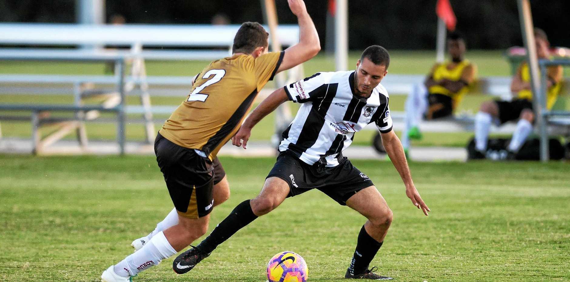 Ipswich City striker and leading goal scorer Ryan Adekoya New (right) battles with a Brisbane Phoenix player.