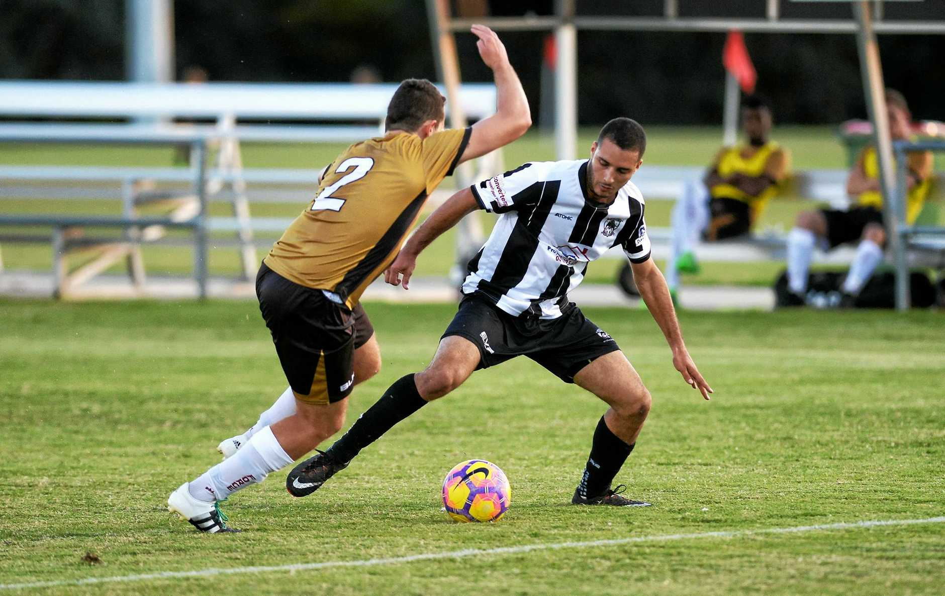 Ipswich City striker and leading goal scorer Ryan Adekoya New (right) battles with a Brisbane Phoenix player.