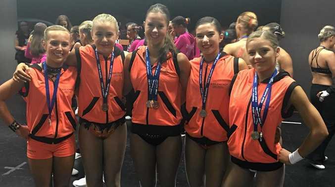 CASS Energy athletes Natalie Giri, Gabi Nash, Tess Reynolds, Paris Warncken, Brooklyn Leonard with their state championship medals.