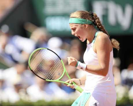 Jelena Ostapenko of Latvia reacts after scoring during the woman's singles semi-final against Timea Bacsinszky of Switzerland