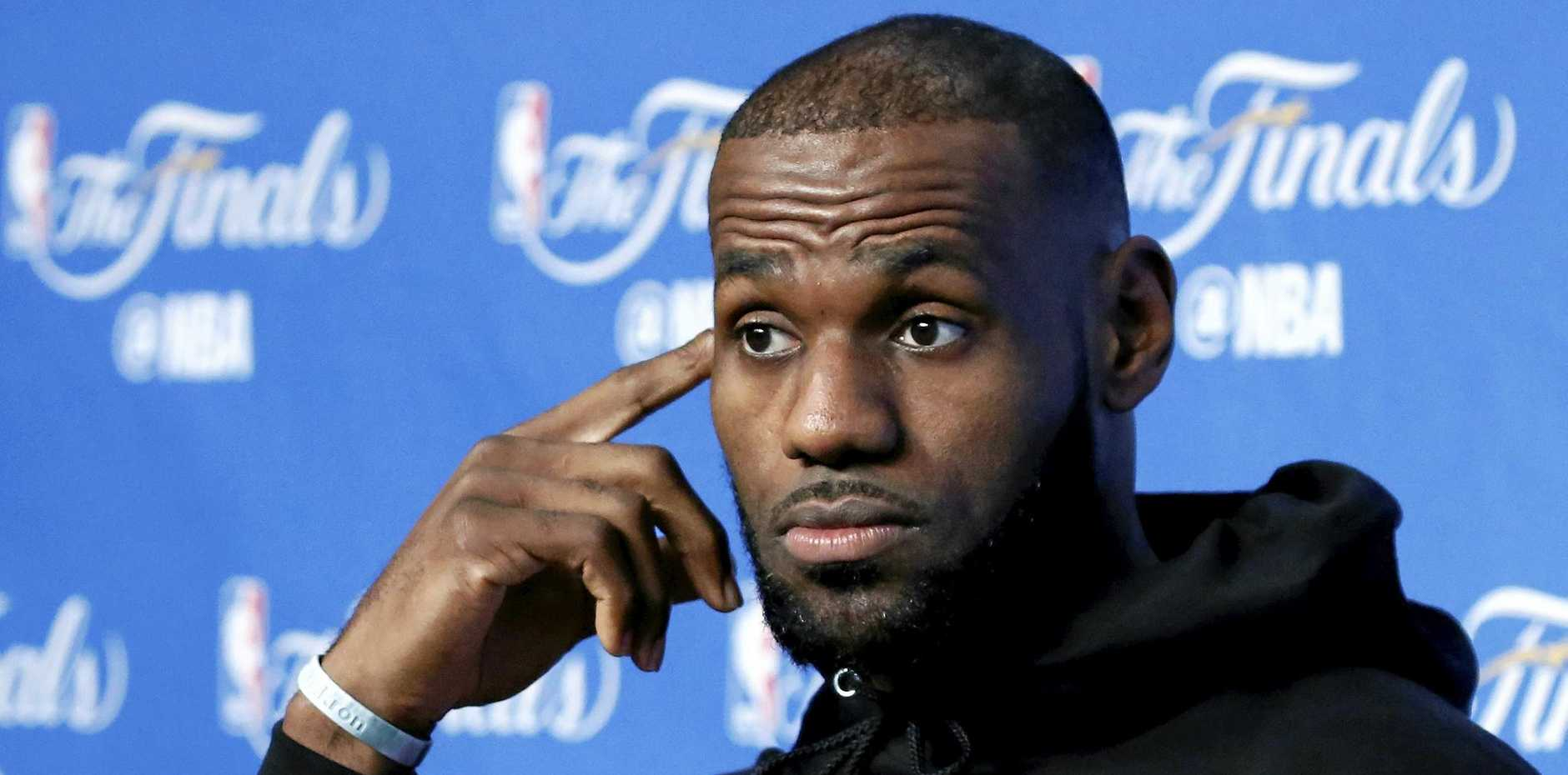 Cleveland Cavaliers player LeBron James talks to the media.