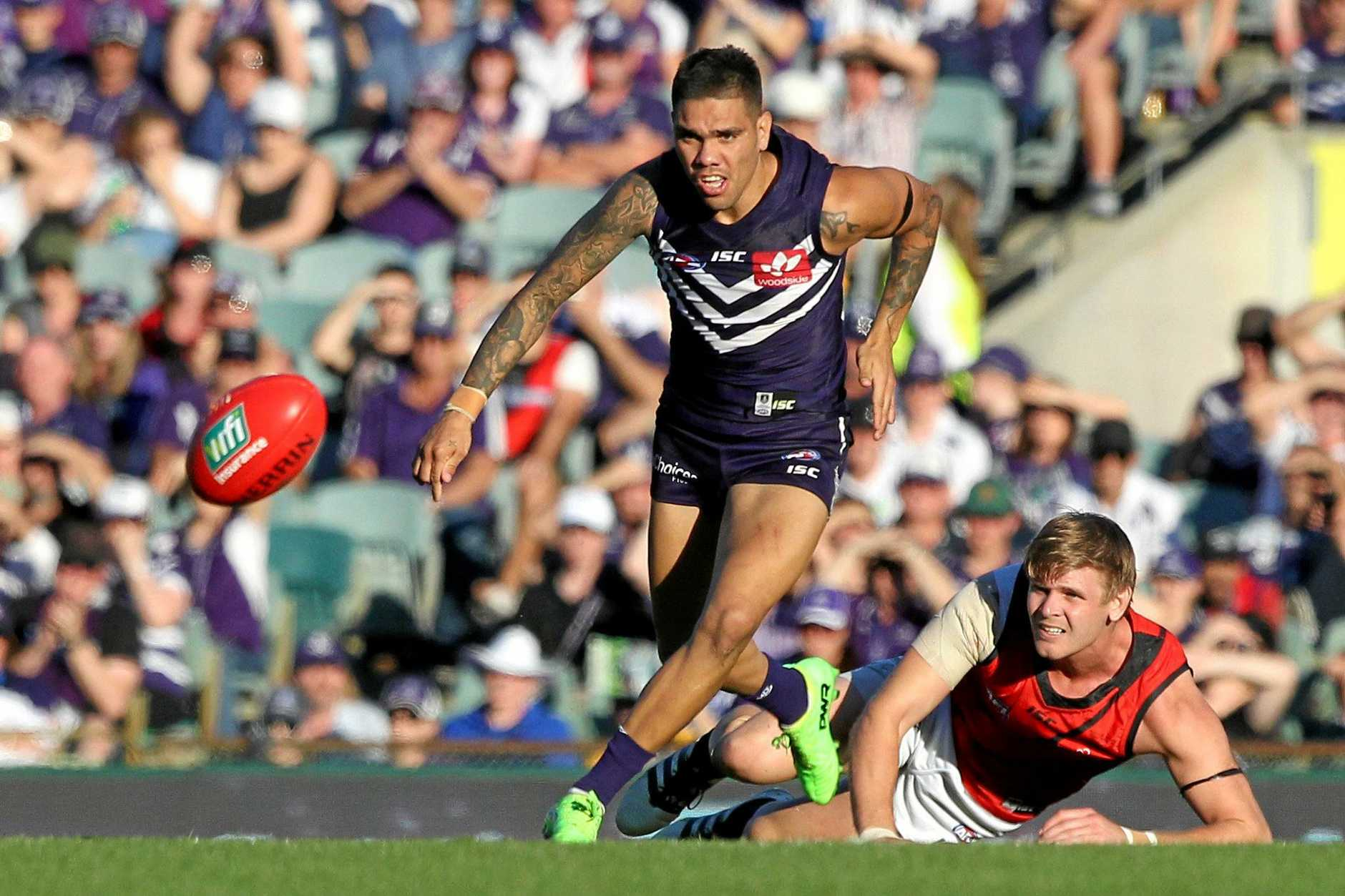 Michael Walters of the Dockers chases down the ball.