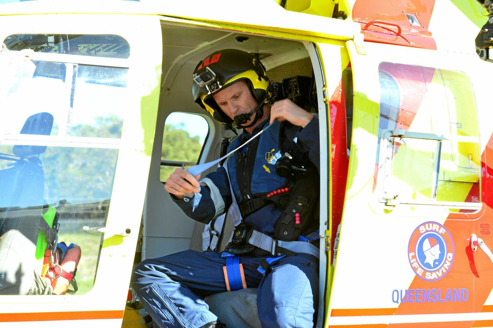 Westpac Lifesaver Rescue Helicopter Service will open the doors of its hangar on July 1 for the community to see its operations. Air crewman Brett Dorrington buckles up.