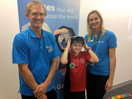 Te Ana Riddell and her father Jason Riddell, both of the University of the Sunshine Coast have fun with Vanessa Boyd's first experience of