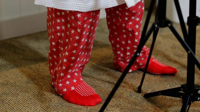 SUPER STAR: The red pants and socks worn by Paul Pisasale during his resignation announcement will be auctioned off for charity.