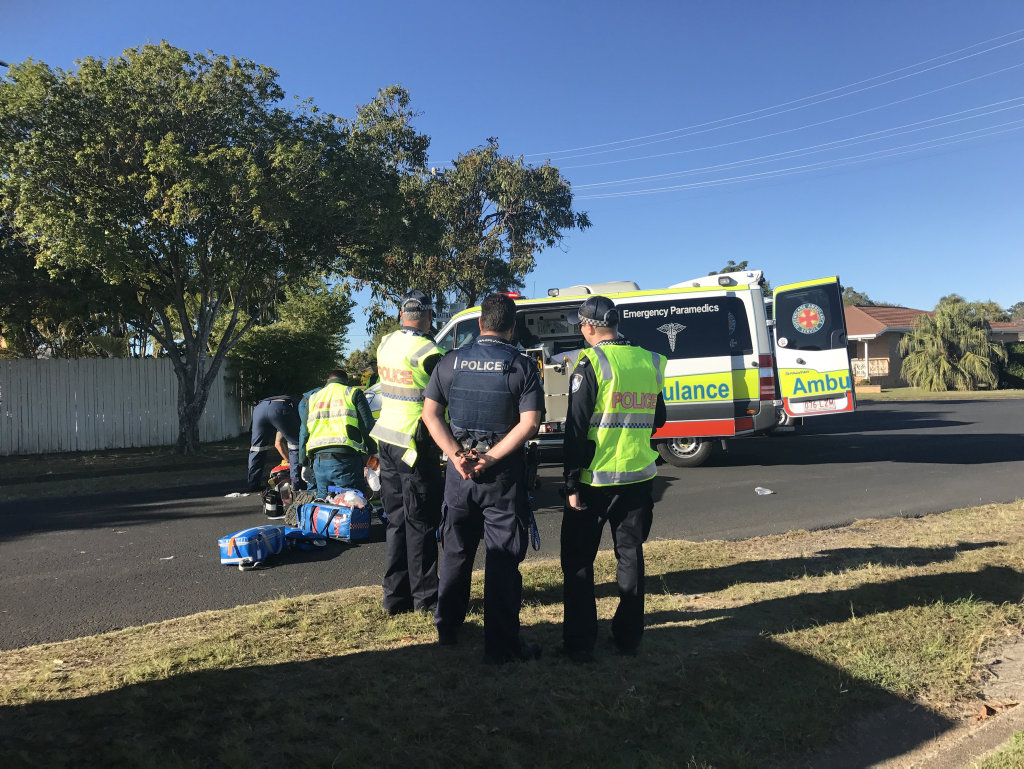 CRASH: Paramedics tend to a motorbike rider after a crash in Avenell Heights.