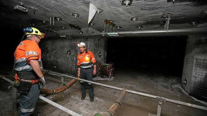 Mastermyne worker Graeme Willett with CEO Tony Caruso in the Underground Mine Simulator they had in 2011.