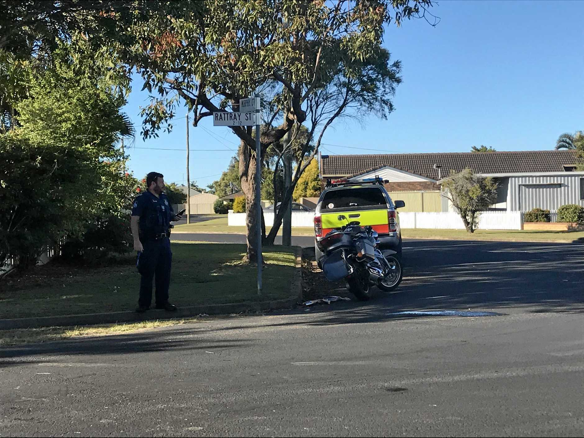 A police officer assesses the scene of the crash.