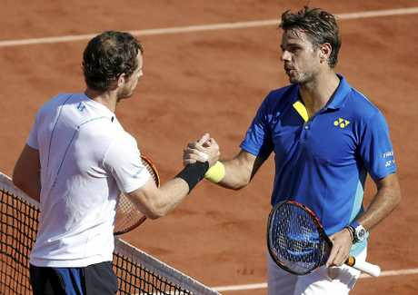 Stanislas Wawrinka of Switzerland (right) shakes hands with Andy Murray of Britain after winning their men's singles semi-final at the French Open.