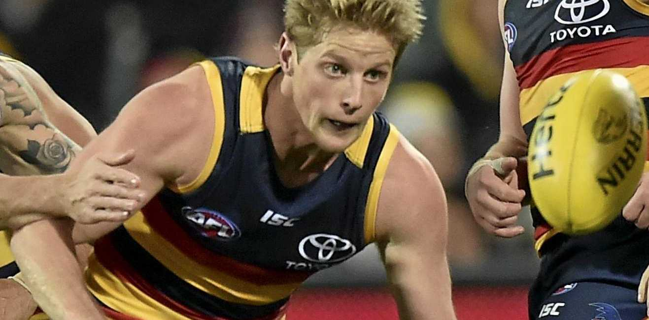 Rory Sloane of the Crows and Nathan Wright of the Saints chase the ball.