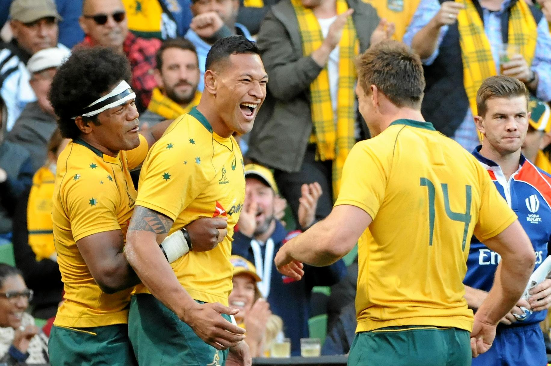 Israel Folau of the Wallabies (centre) celebrates with teammates after he scored his side's third try against Fiji.