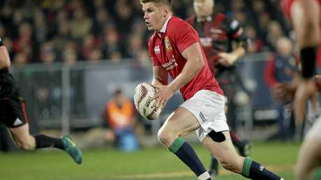 British and Irish Lions flyhalf Owen Farrell runs with the ball against the Crusaders.