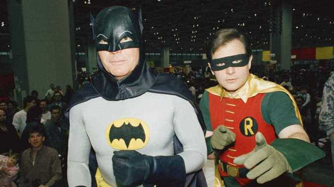 Actors Adam West, left, and Burt Ward, dressed as their characters Batman and Robin, pose for a photo at the