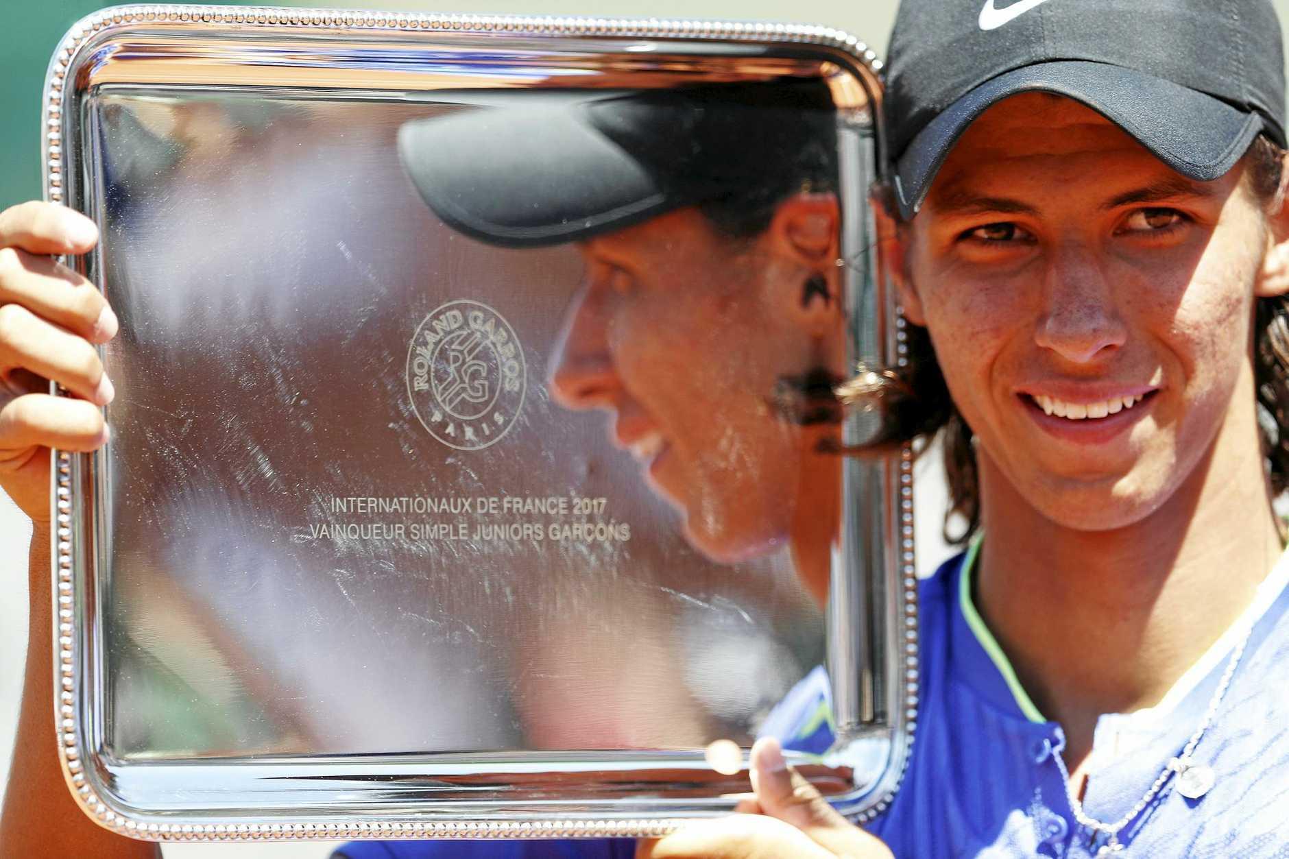 YOUNG CHAMPION: Australia's Alexei Popyrin was all smiles the French Open boy's title.