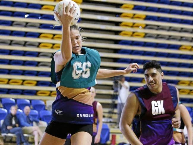 HARD WORK: Sunshine Coast Lightning goal shooter Caitlyn Bassett claims possession of the ball during a practice session ahead her side's Suncorp Super Netball grand final this weekend. Photo: Lachie Millard/News Corp Australia