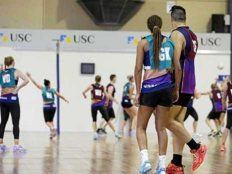 Geva Mentora and Junior Levi watch play during a practice match between the Lightning and the Queensland men's netball team. Photo: Lachie Millard/News Corp Australia