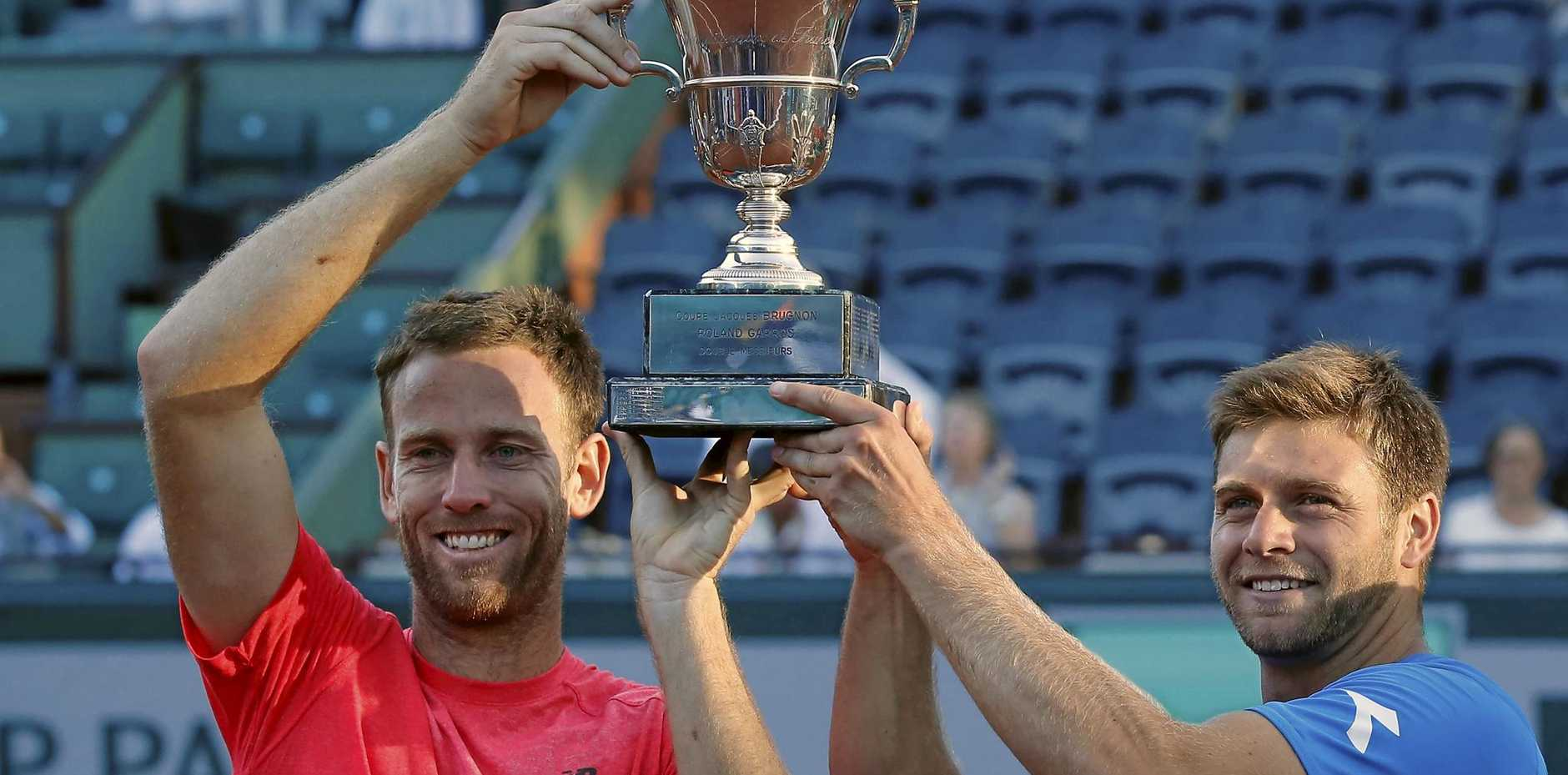 CHAMPIONS: American Ryan Harrison and Kiwi Michael Venus celebrate winning the French Open men's doubles title.