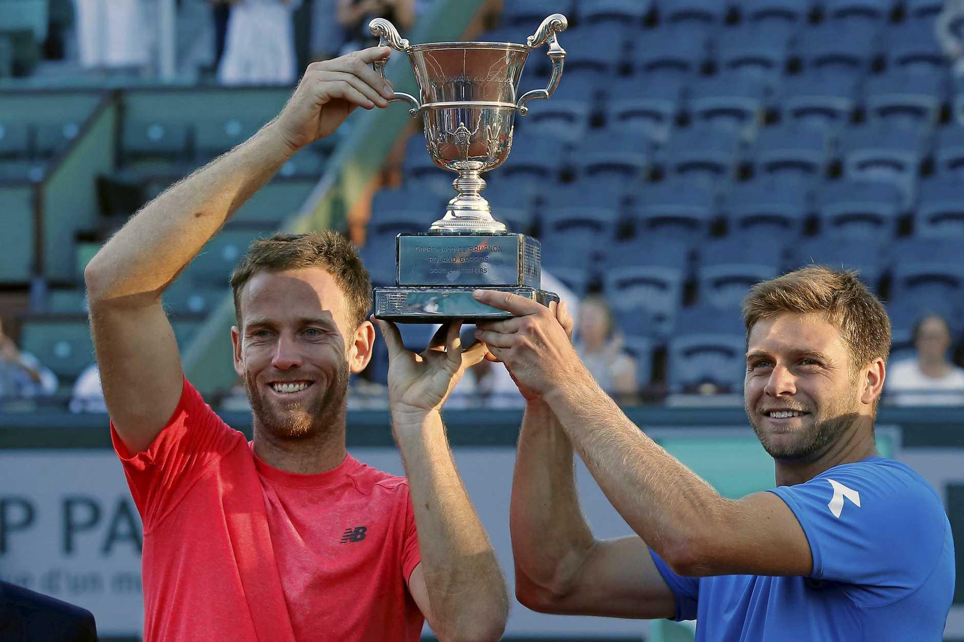 CHAMPIONS: American Ryan Harrison and Kiwi Michael Venus celebrate winning the French Open men's doubles title.