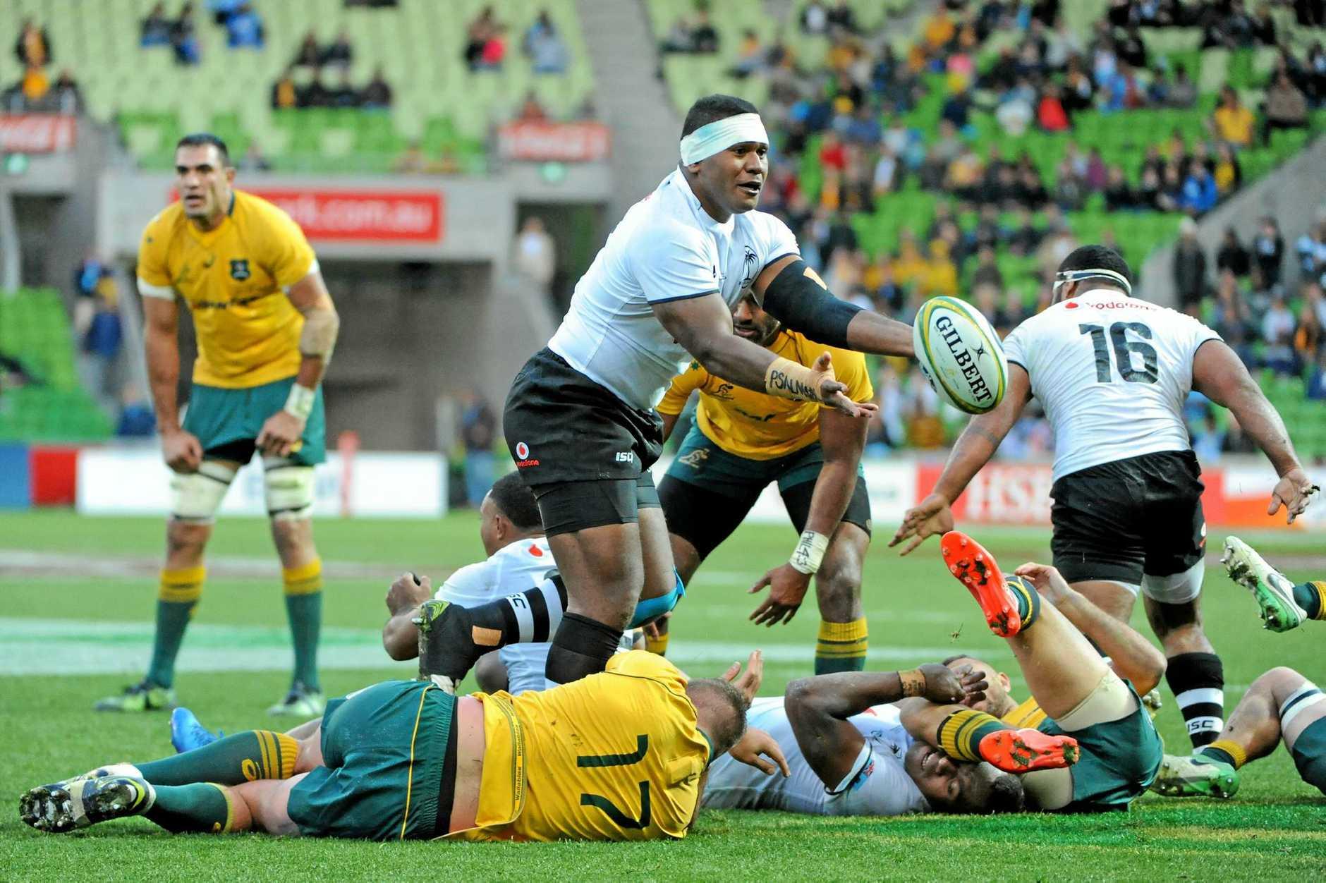 Fiji's Joeli Veitayaki fires off a pass.