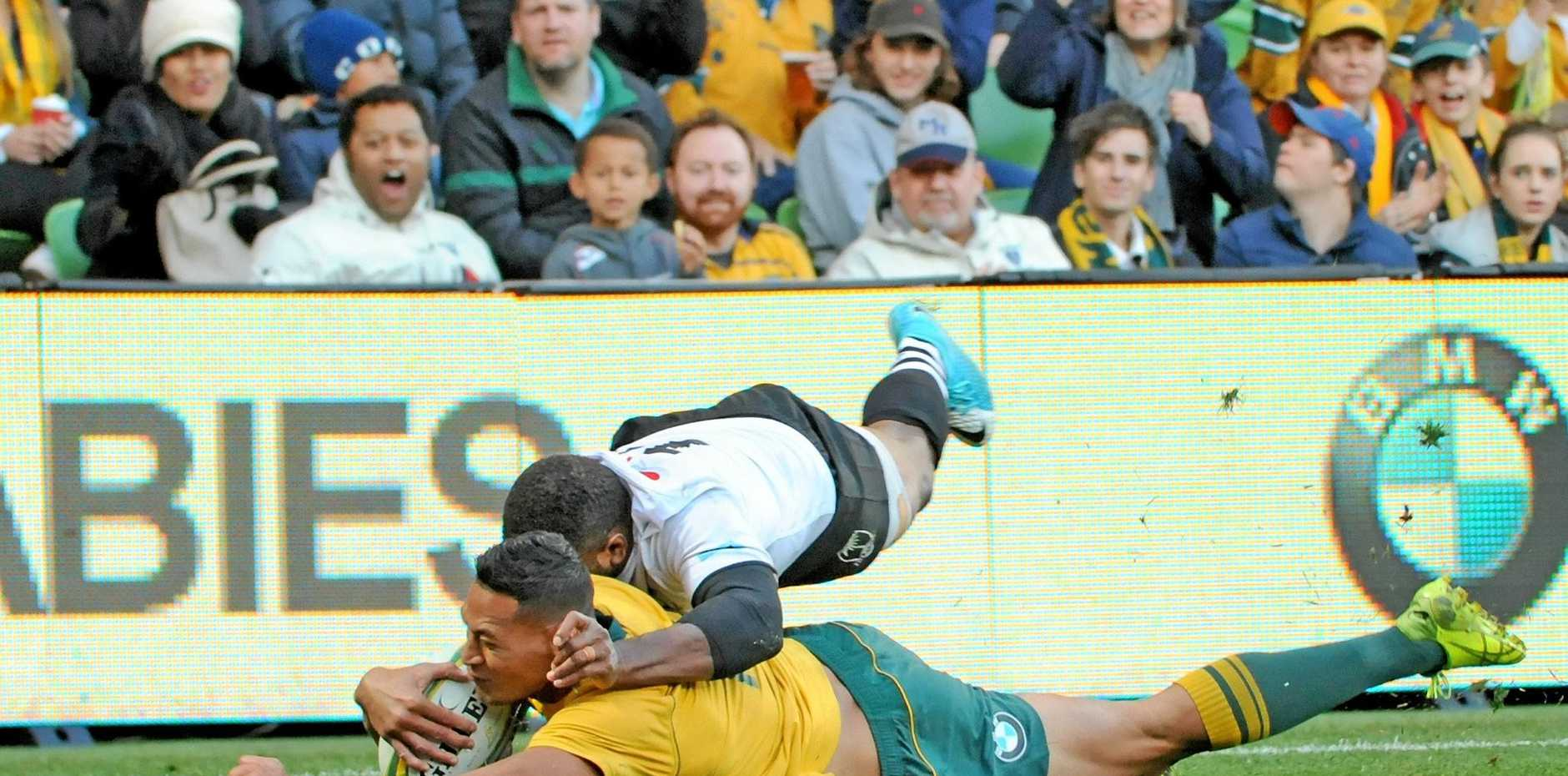 TRY TIME: Wallabies fullback slides in for a try in his side's 37-14 Test victory over Fiji.