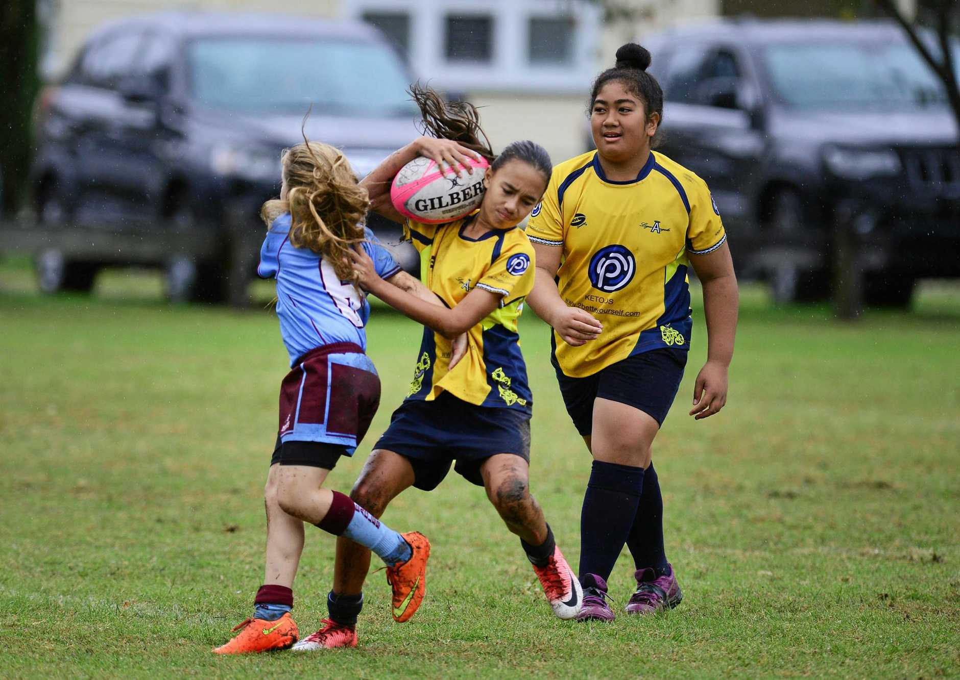 RUGBY SEVENS: The Under 12s from Logan Angels and Norths Eagles in action at Woodend Park.