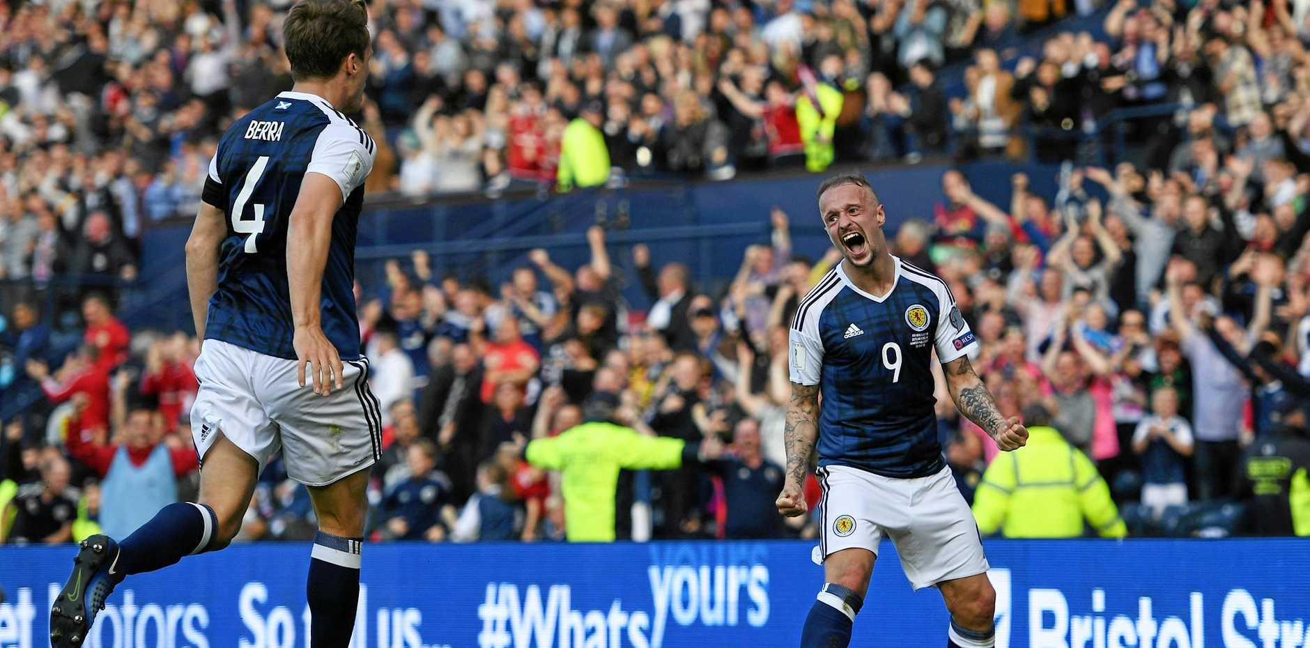 STUNNING STRIKE: Scotland's Leigh Griffiths celebrates scoring his side's second goal during the FIFA 2018 World Cup Qualifier against England at Hampden Park.