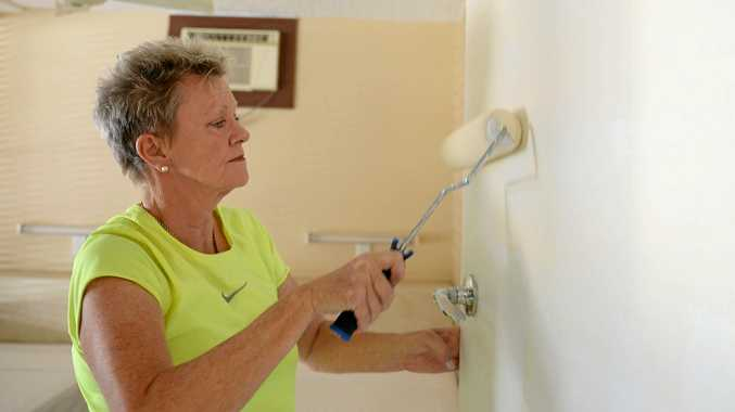 FRESH DIRECTION: Jan Tyrrell working on the Ambassador Motel re-vamp. INSET: One of the re-vamped rooms.