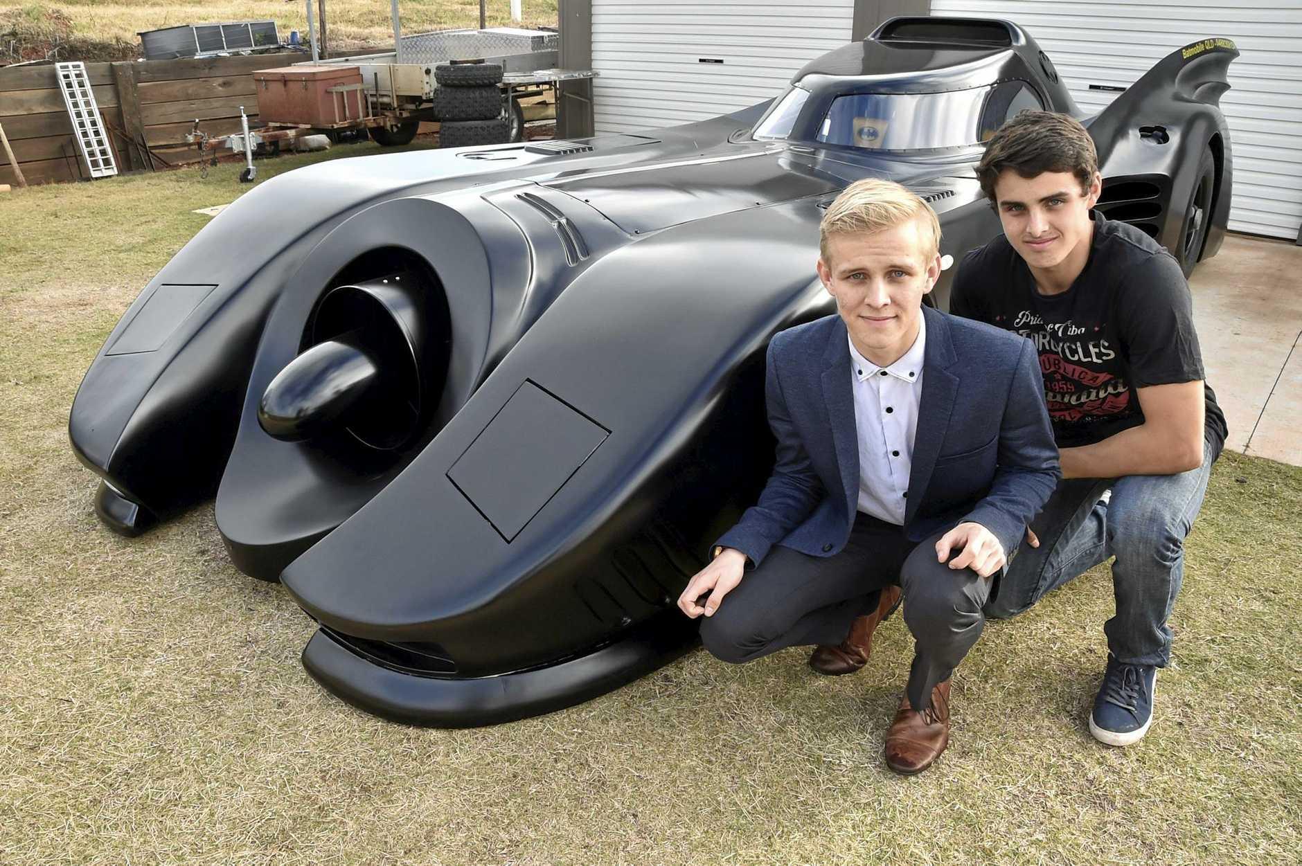 PAYING RESPECT: Batman fans Shaun (left) and Stuart Blackburn honour actor Adam West's famed role with their Batmobile.