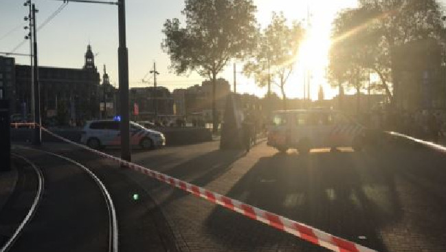Car 'crashes into pedestrians' outside Amsterdam train station.