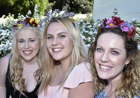 Celebrating the Carnival on a perfect spring day are (from left) Kelsey Lynn, Ashleigh Lovegrove and Rhianna Lynn at last year's Ergon Engery Food and Wine Festival.