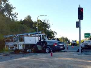 Truck and car crash blocks Sunshine Mwy lane